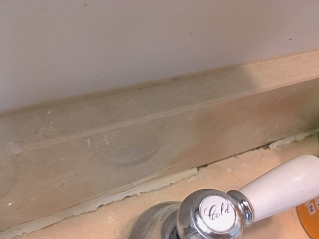 bathroom caulking repair